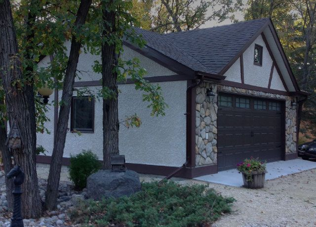 Detached garage with stone accents