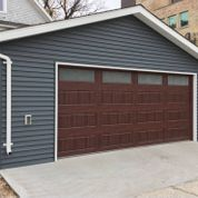 view of a detached garage with brown door